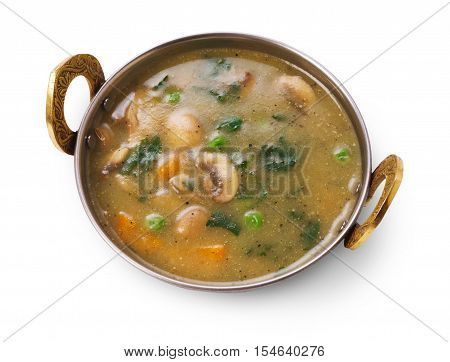 Vegan and vegetarian dish, hot spicy and creamy mushroom indian soup bowl. Traditional indian cuisine meal isolated on white background. Healthy eastern local cuisine restaurant food