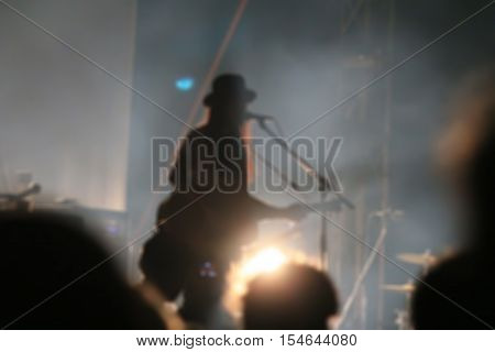 Blurred image : Blurred singer in night concert