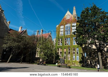 Manchester United Kingdom - September 18 2016: Manchester University Office main campus buildings with students enjoying the early morning sun.