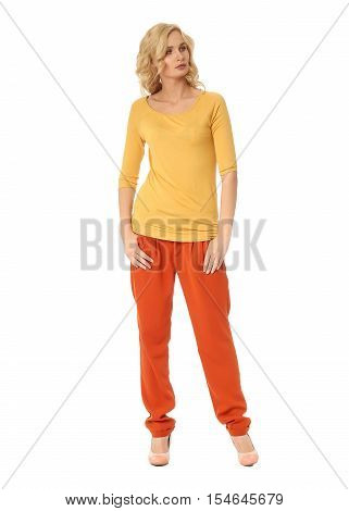 Blond Fashion Model Girl Stand In Orange Trousers Isolated