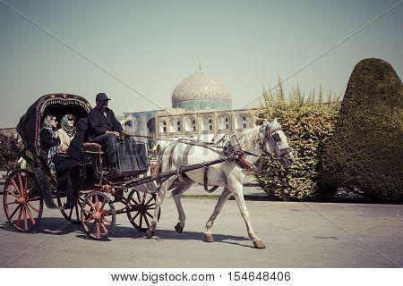 ISFAHAN IRAN - OCTOBER 06 2016: A horse and carriage at Naqsh-e Jahan Square in Isfahan Iran.