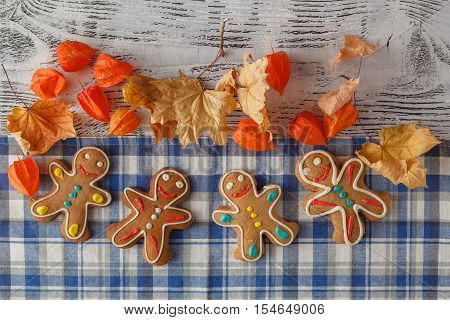Gingerbread Men Lined Up On A Natural Wood Background As A Boarder.