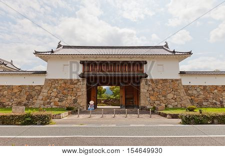 MAIZURU JAPAN - JULY 29 2016: Reconstructed in 1997 Main Gate of Tanabe castle. Castle was erected in 1579 by Hosokawa Fujitaka abandoned in 19th c. partly reconstructed in 1940 and 1997
