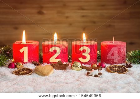 Three Advent Candles Lit In Snow