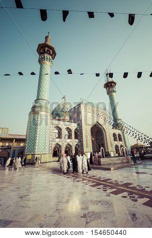 TEHERAN IRAN - OCTOBER 03 2016: People walking around Emamzadeh Saleh in Teheran Iran.