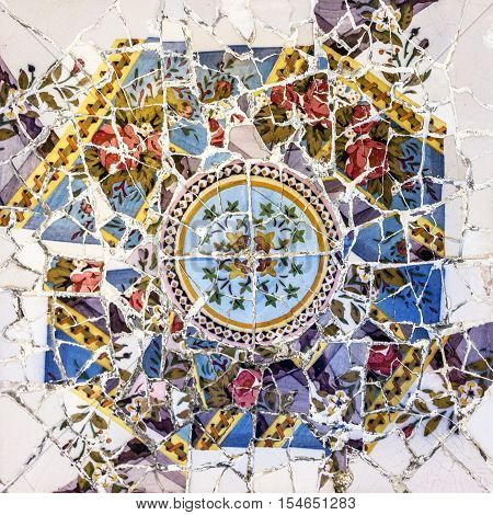 Mosaic tile decoration broken glass, Park Guell, Barcelona, Spain. Designed by Gaudi