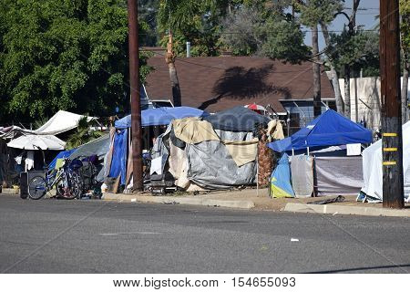 October 22, 2016 in Pomona, CA:  Row of tents where homeless people reside also known as Tent City near social services and where homeless people are allowed to stay taken in Pomona, CA