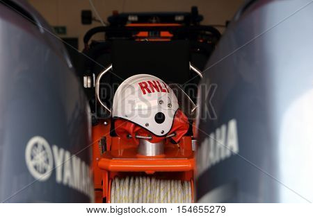 Littlehampton, Uk - October 25 2016: Rnli (royal National Lifeboat Institution) Helmet Ready On A Li