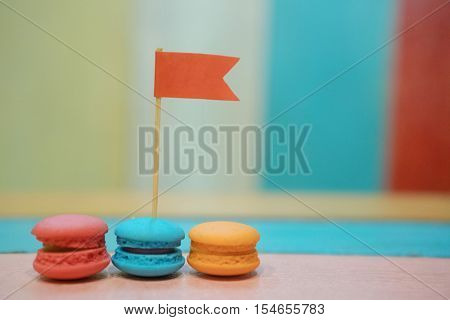 Multicolored macaroons on white wooden background. . Macaron or Macaroon is sweet meringue-based confection