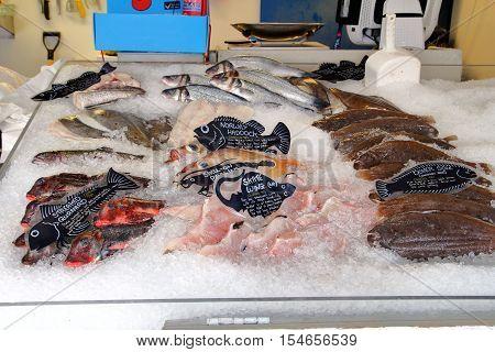Littlehampton UK - October 25 2016: Fresh fish on ice in a traditional English fishmonger
