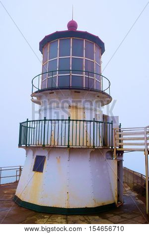 Pt Reyes Light Station built in 1870 which is a historical landmark surrounded by fog taken in Pt Reyes, CA