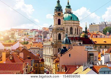 Cityscape view on the lesser town with saint Nicholas church in Prague city