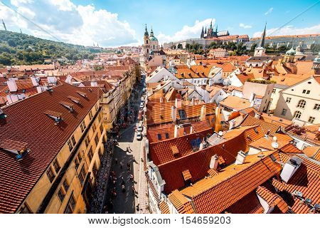 Cityscape aerial view on the Lesser town with castle hill and churches in Prague city