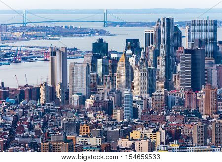 New York - April of 2015, USA: Aerial view of Manhattan skyscrapers downtown and Verrazano Narrows bridge