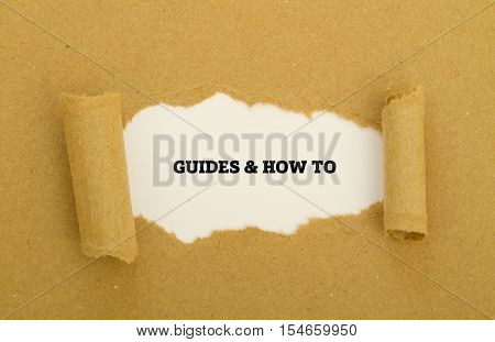GUIDES AND HOW TO written under torn paper.