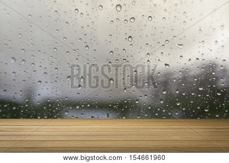 Wooden Desk Or Wooden Floor On Water Drop Of The Rain Background Vintage Tone Process.use For Presen
