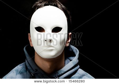 young man with white mask, studio shot