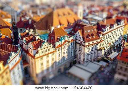 Top view on the buildings on the old town square during the sunset in Prague. Blurred image with tilt-shift technic
