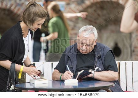 Wroclaw, Poland, June 28, 2014 Andrzej Sapkowski Sign A Witcher Book For The Fan, Authot Of