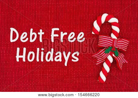 Christmas Debt Free message Red shiny fabric with a candy cane with text Debt Free Holidays
