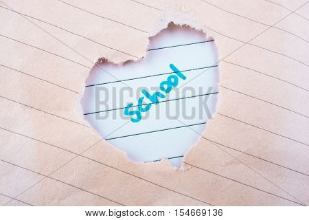 Hole Made In Paper On The Form Of A Heart