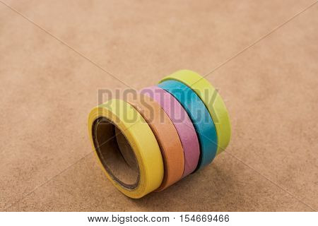 colorful insulating adhesive tapes on yellow background