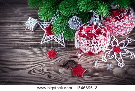 Christmas decoration with firtree and red balls on old wooden board holiday card copyspace