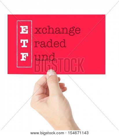 Exchange Traded Fund explained on a card held by a hand