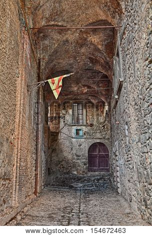Bolsena, Viterbo, Lazio, Italy: ancient picturesque covered street in the old town, a mysterious dark alley in the medieval city by the lake