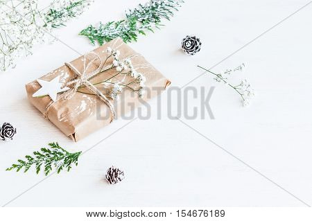 Christmas composition. Christmas gift pine cones thuja branches and gypsophila flowers