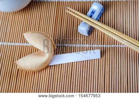 Fortune Cookie With Blank Slip And Chopsticks And Cups