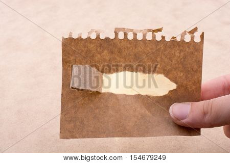Hand Holding Brown Notepaper