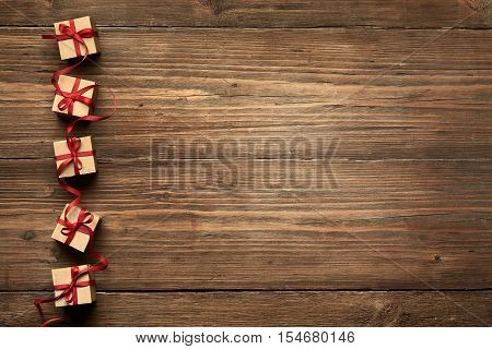 Gift Boxes on Wood Background Christmas Presents Red Ribbon Bow over Wooden Decoration