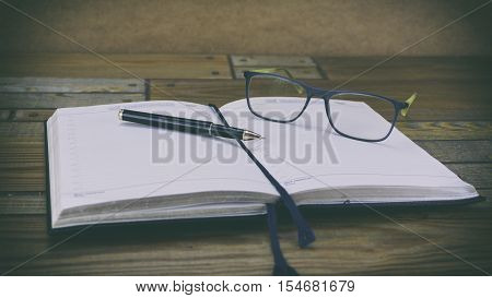 Diary And Glasses, Diary On A Wooden Background Ballpoint Pen