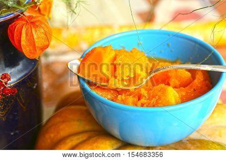 smashing pumpkin in blue bowl close up photo