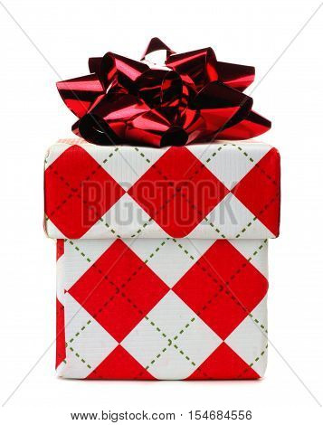 Red And White Argyle Patterned Christmas Gift Box With Shiny Bow Isolated On A White Background