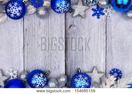 Blue And Silver Christmas Ornament Double Border With Snow Frame On A Rustic White Wood Background