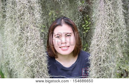 Asian women smile face in Thailand with grass mustache hermit.