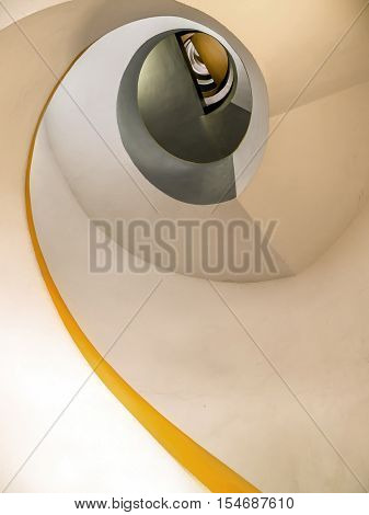 A spiral staircase looking up