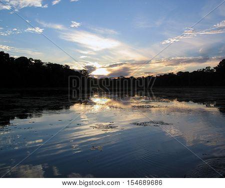 A sunset in a lagoon in the Amazon Jungle in Manu, Peru