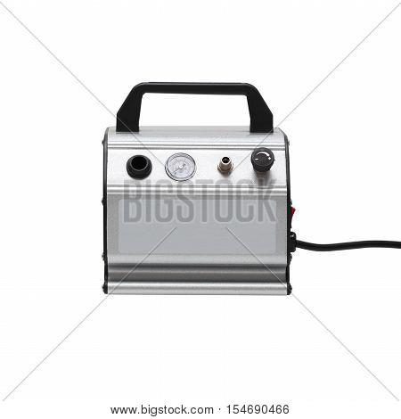 Portable car air compressor. Compressor on white background