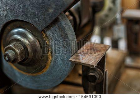 Close up board emery wheel in workshop