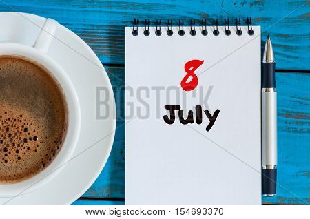 July 8th. Day 8 of month, calendar on business workplace background with morning coffee cup. Summer concept. Empty space for text.
