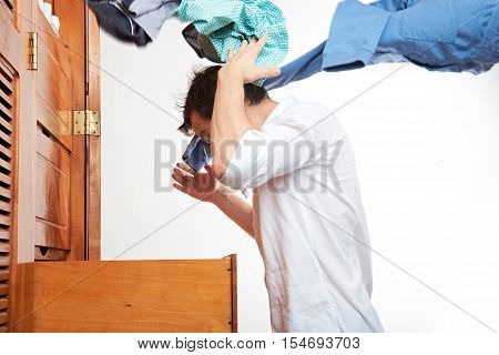 Profile Of Man Throwing Clothes