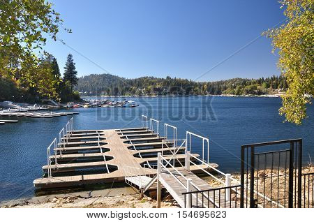 An empty boat dock frames this view of Lake Arrowhead in Southern California.