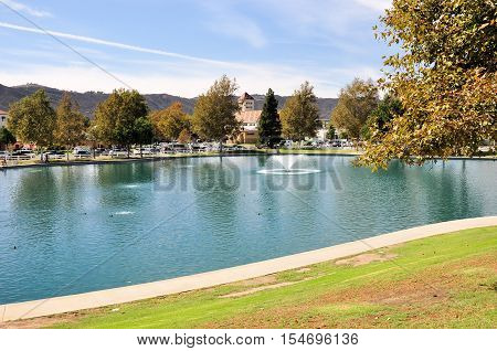 View of a duck pond and fountain at a city park in Temecula, California.