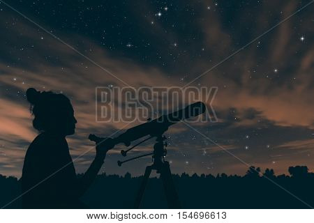 Woman With Astronomical Telescope. Night Sky, With Clouds And Constellations.