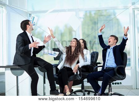business people excited happy smile, throw papers, documents fly
