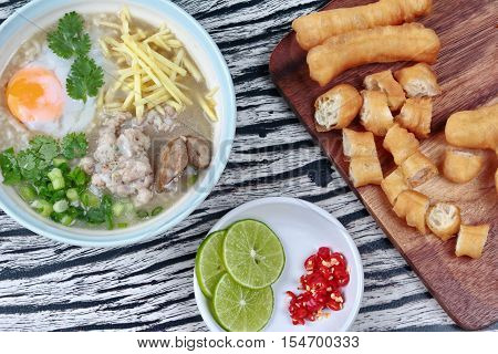Close up,Rice porridge with mined pork and chicken lever served with side dish as Patongko (deep-fried dough stick) and spicy sour filling.