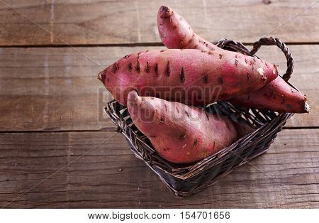 Sweet Potato Over Rustic Wooden Background